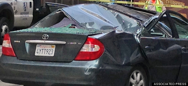 Window Washer Survives 11-Story Fall Onto Moving Car