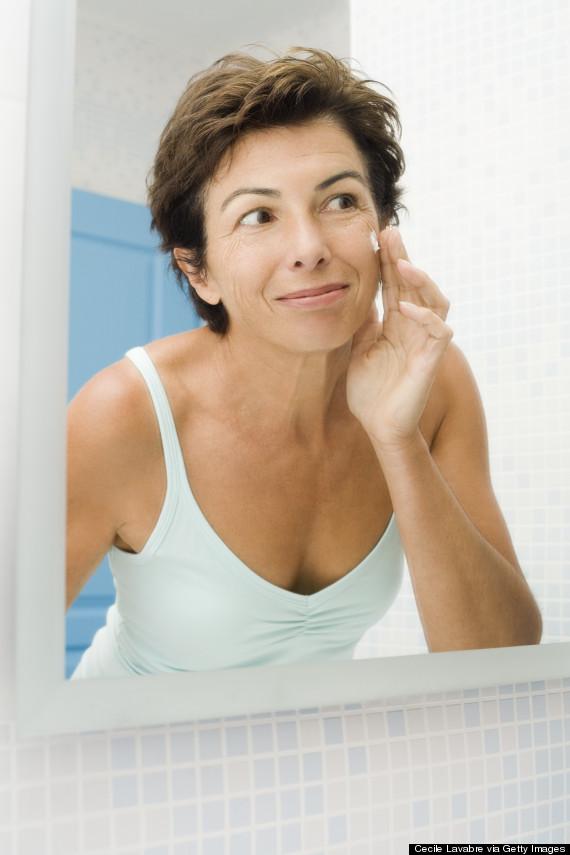 applying cream mirror