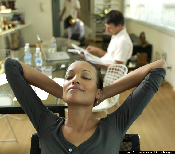 woman stretching desk