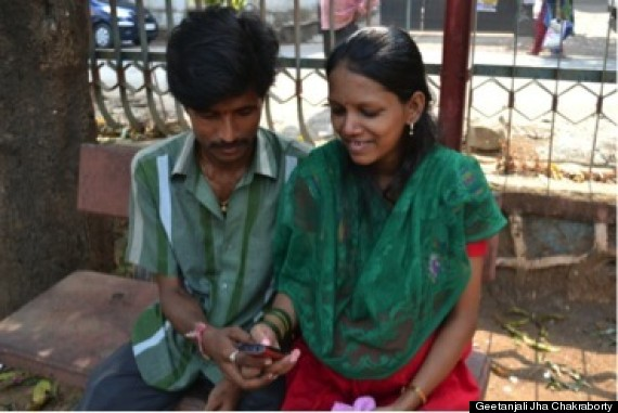 a young couple listening to mmitra call
