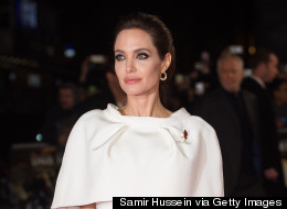 Angelina Wows In White