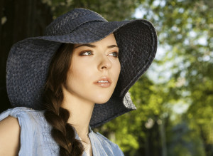 ELEGANT WOMAN WITH BRAID AND HAT
