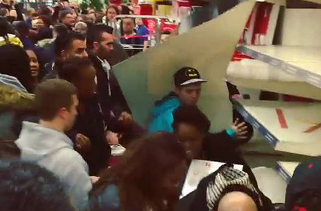 People fighting in a shop