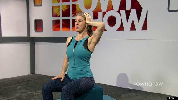 jill miller demonstrating neck pain relief stretch