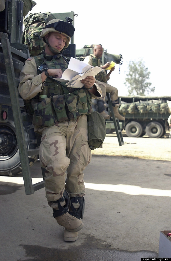 soldier reading mail