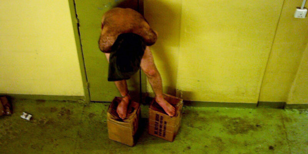 the abu ghraib prison scandal An iraqi inmate at abu ghraib prison terrorized by dogs us army / criminal investigation command (cid) in may 2009 barack obama announced that.