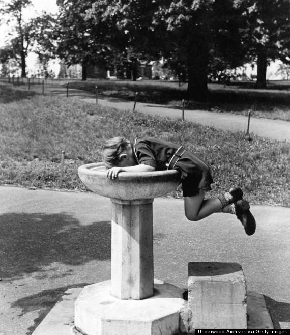 child drinking fountain