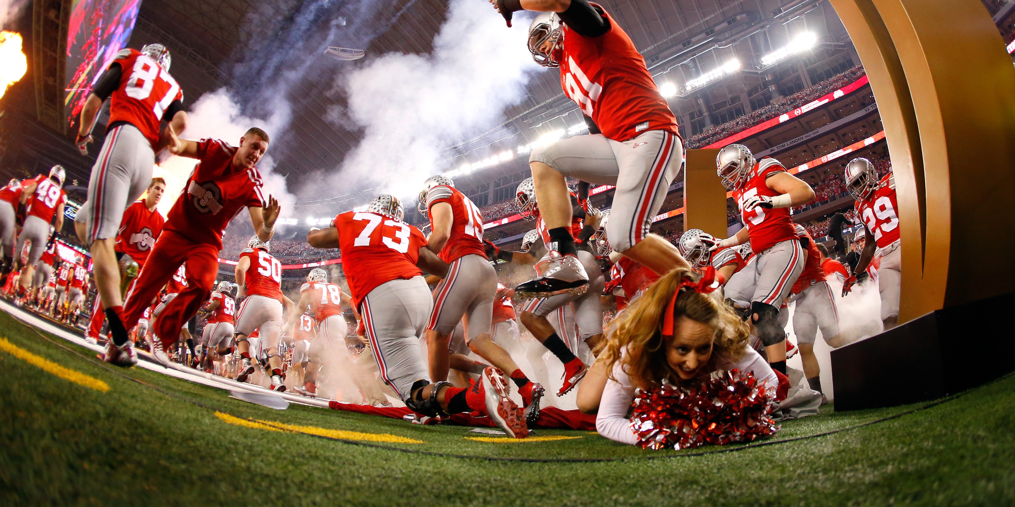 college football pictures videos breaking news look ohio state cheerleader nearly trampled by team in entrance fail
