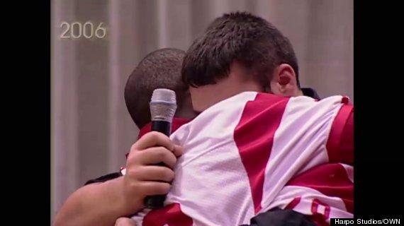 high school football players hugging on oprah