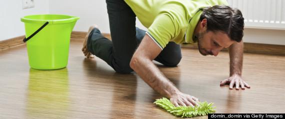 man scrubbing floor