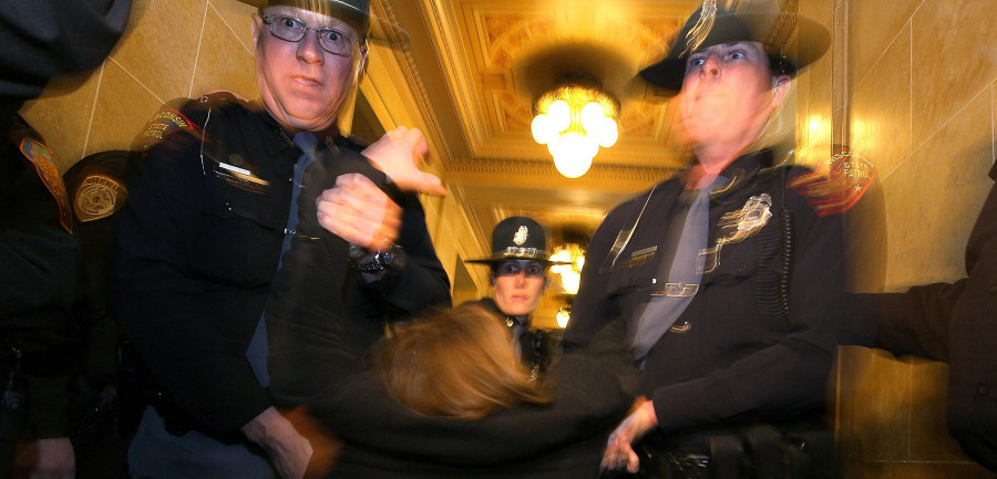Police violate protesters Constitutional rights, drag them from Wisconsin capital ( Image credit Huffington Post )
