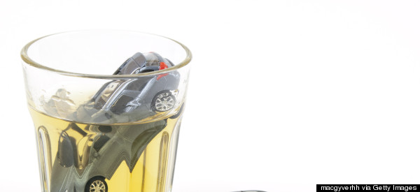 BOTTOMS UP! Cops Allegedly Find Driver Sitting Pantless On Whisky Bottle