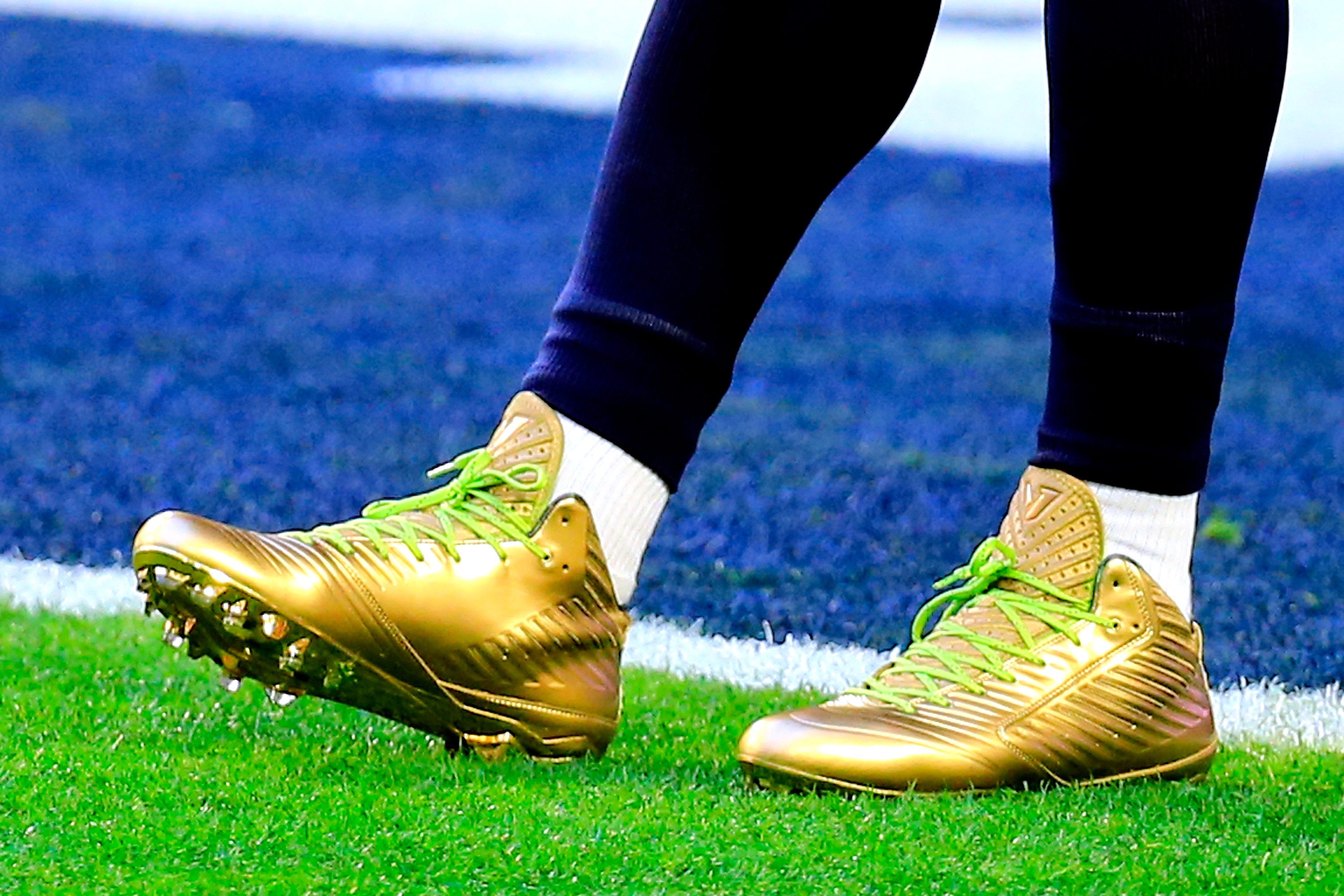 gold cleats close up