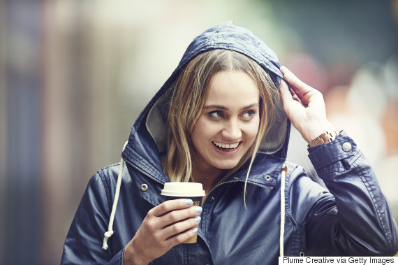 woman sipping coffee to go