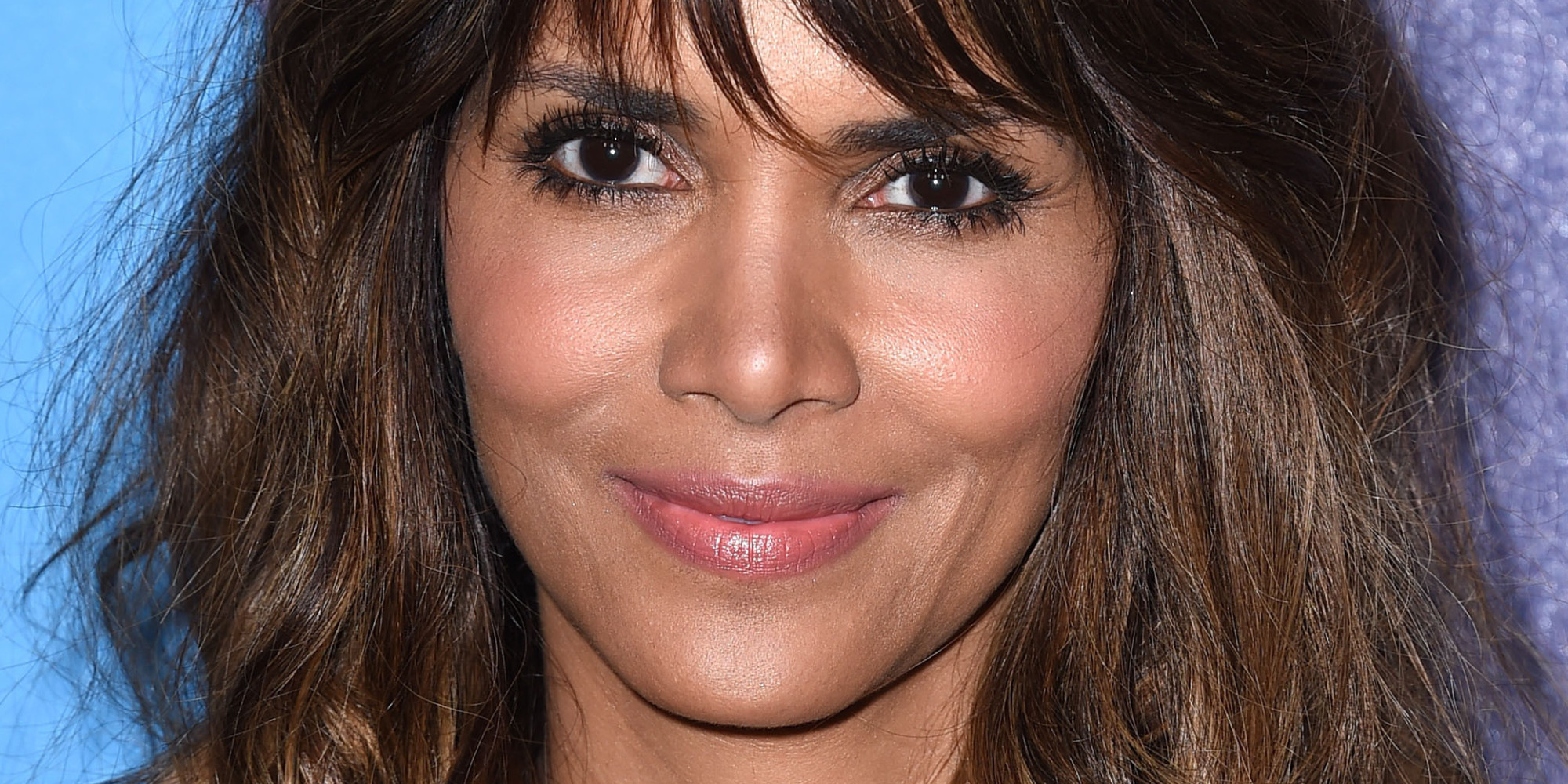 Outstanding Halle Berry Rocks Long Wavy Hair And A Little Black Dress The Short Hairstyles For Black Women Fulllsitofus