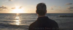 MAN LOOKING SEA
