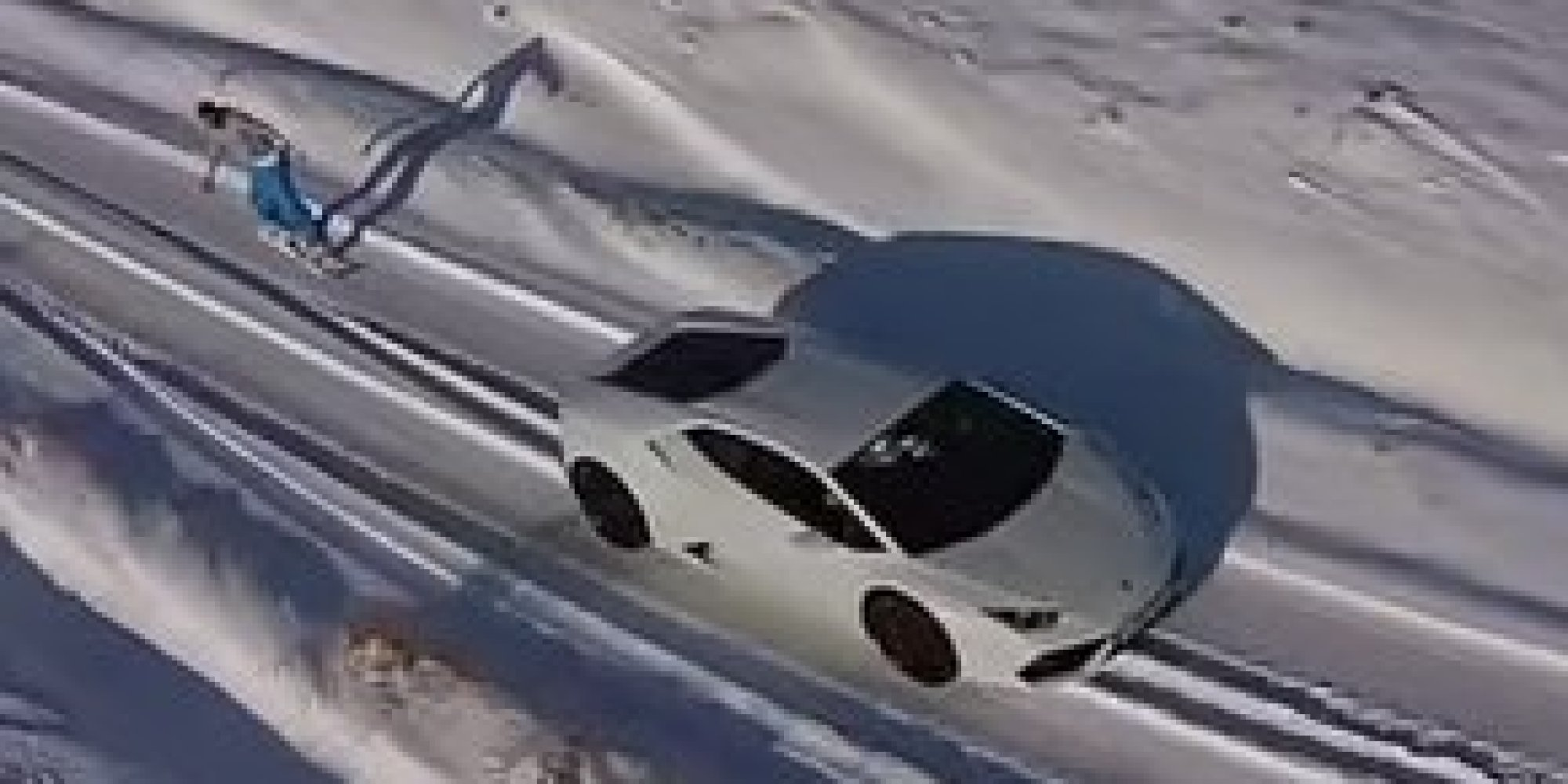 snowboarding with a lamborghini looks as bizarre as it sounds huffpost. Black Bedroom Furniture Sets. Home Design Ideas