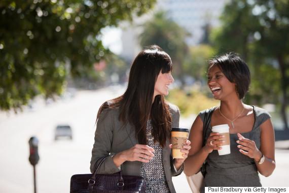 friends walking drinking coffee