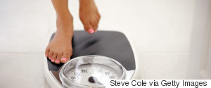 WOMAN ON WEIGHING SCALES