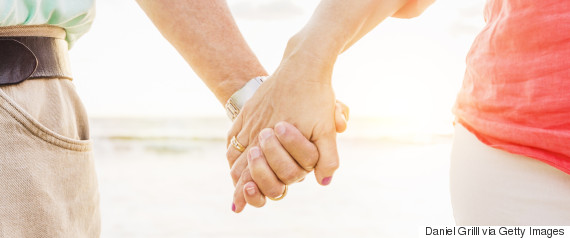 mature couple holding hands