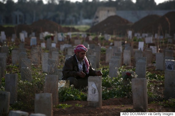 syrian man grave son