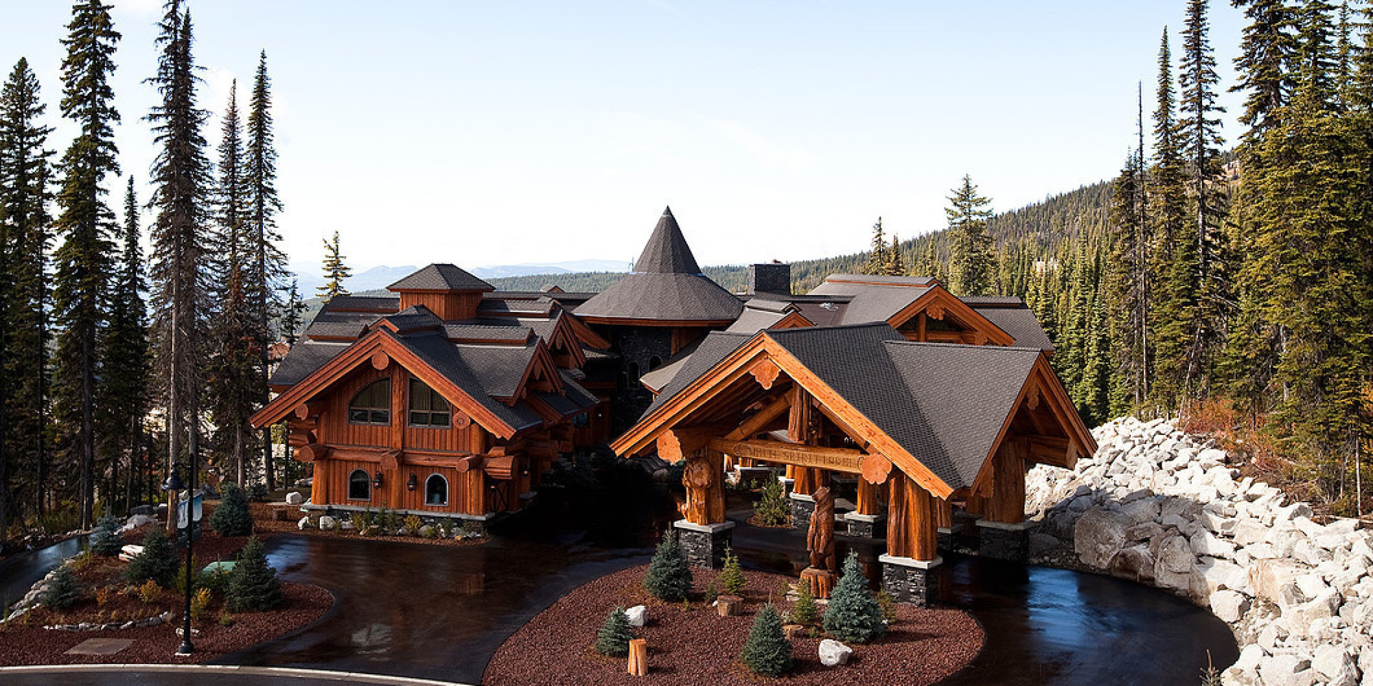 Big white luxury log castle crafted from centuries old Big log cabin homes