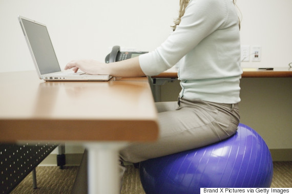 woman exercise ball desk