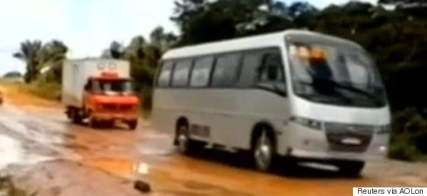 WATCH: Huge Brazilian Sinkhole Swallows Bus, Carries It Downriver
