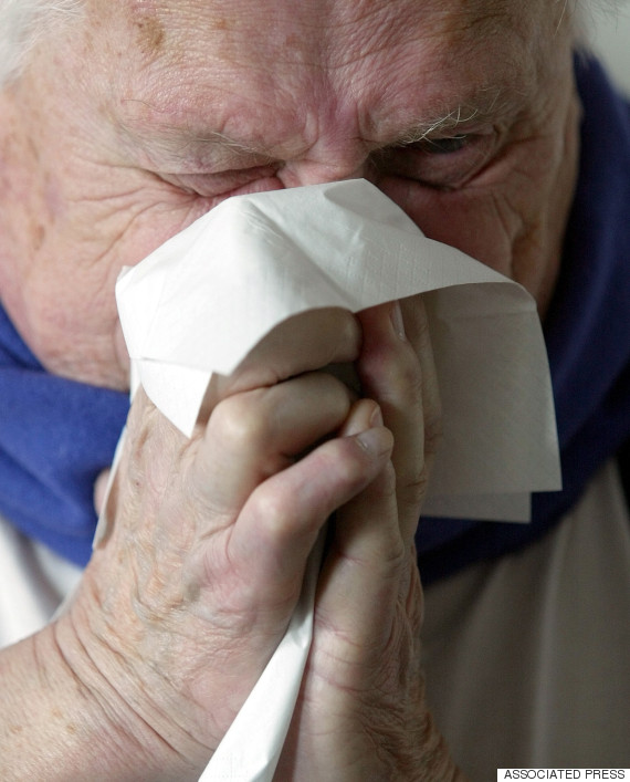 elderly man sneezing