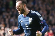 Scotland player celebrates | Pic: PA
