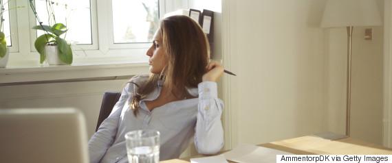 woman thinking pen