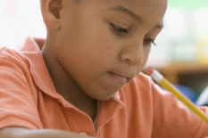 Stock image of a boy in class | Pic: Getty