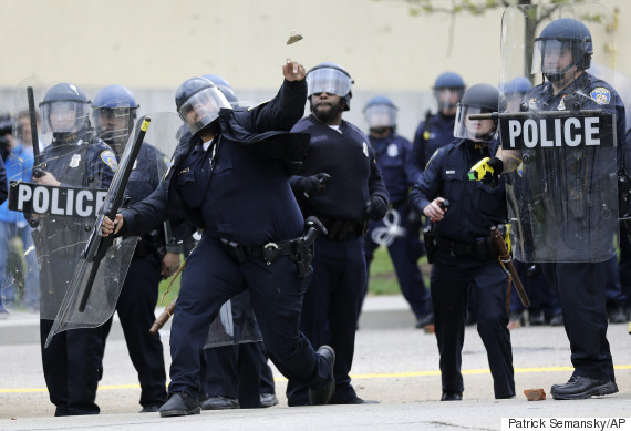 Police Throw Rocks Back At Protesters In Baltimore