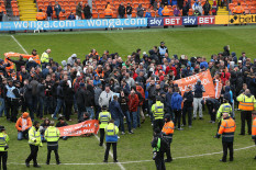 Blackpool fans protest on the pitch | Pic: EMPICS