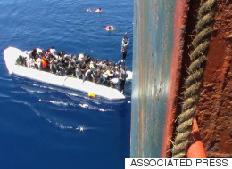 Dramatic Video: Migrants Rescued From Sinking Boat