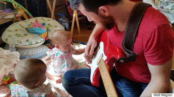 dad playing guitar twins