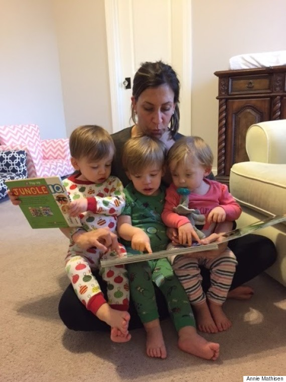 mom reading to triplets