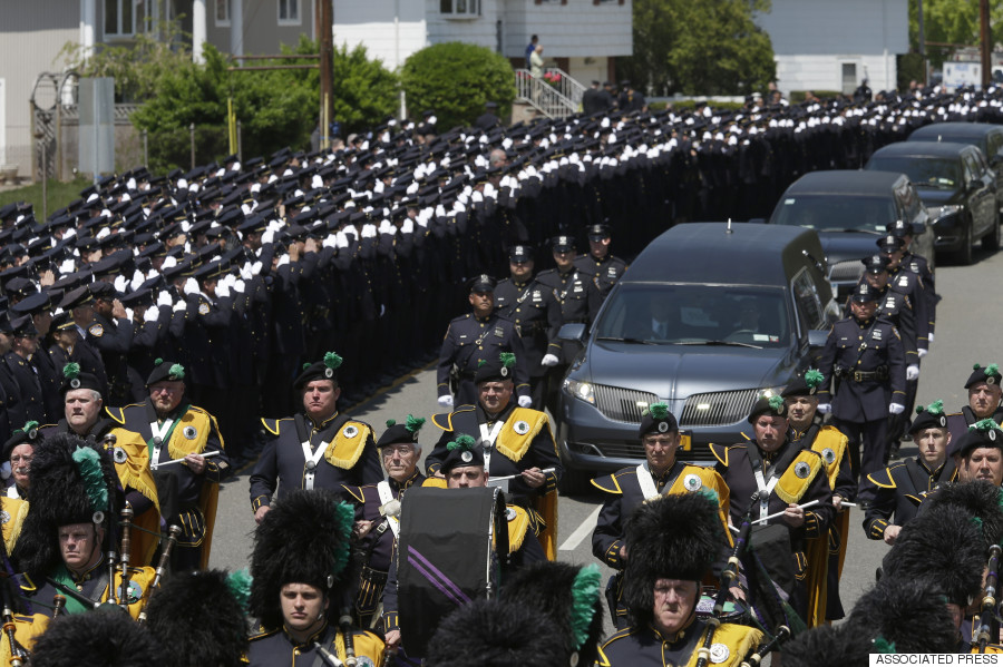 thousands of police mourn one of their own at funeral for brian