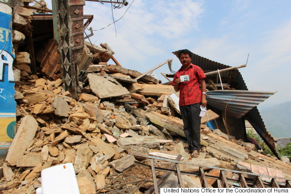 man on rubble at nepal earthquake