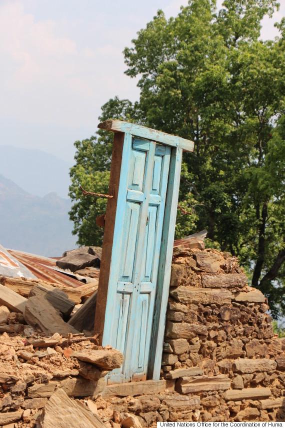 blue door in nepal earthquake rubble
