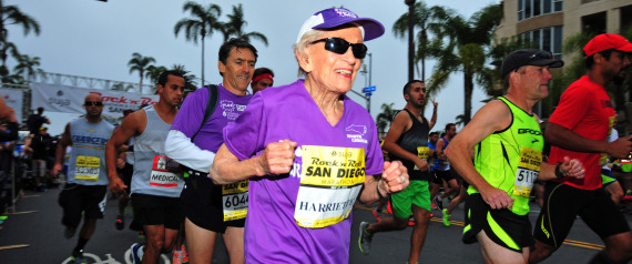 A 92-year-old cancer survivor rocked her way into the record books Sunday, becoming the oldest woman to finish a marathon.