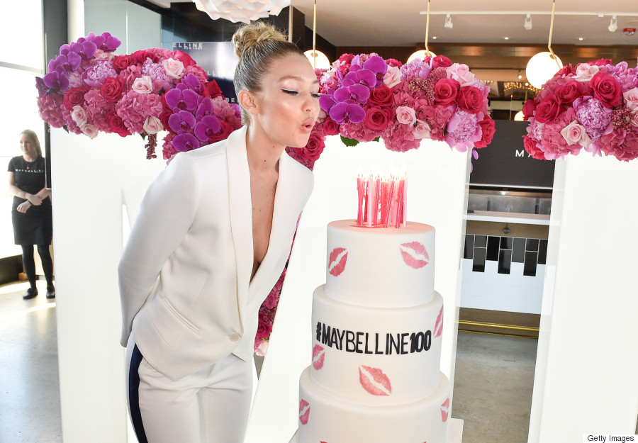 Gigi Hadid Stuns In White Pantsuit At Maybelline 100 Party