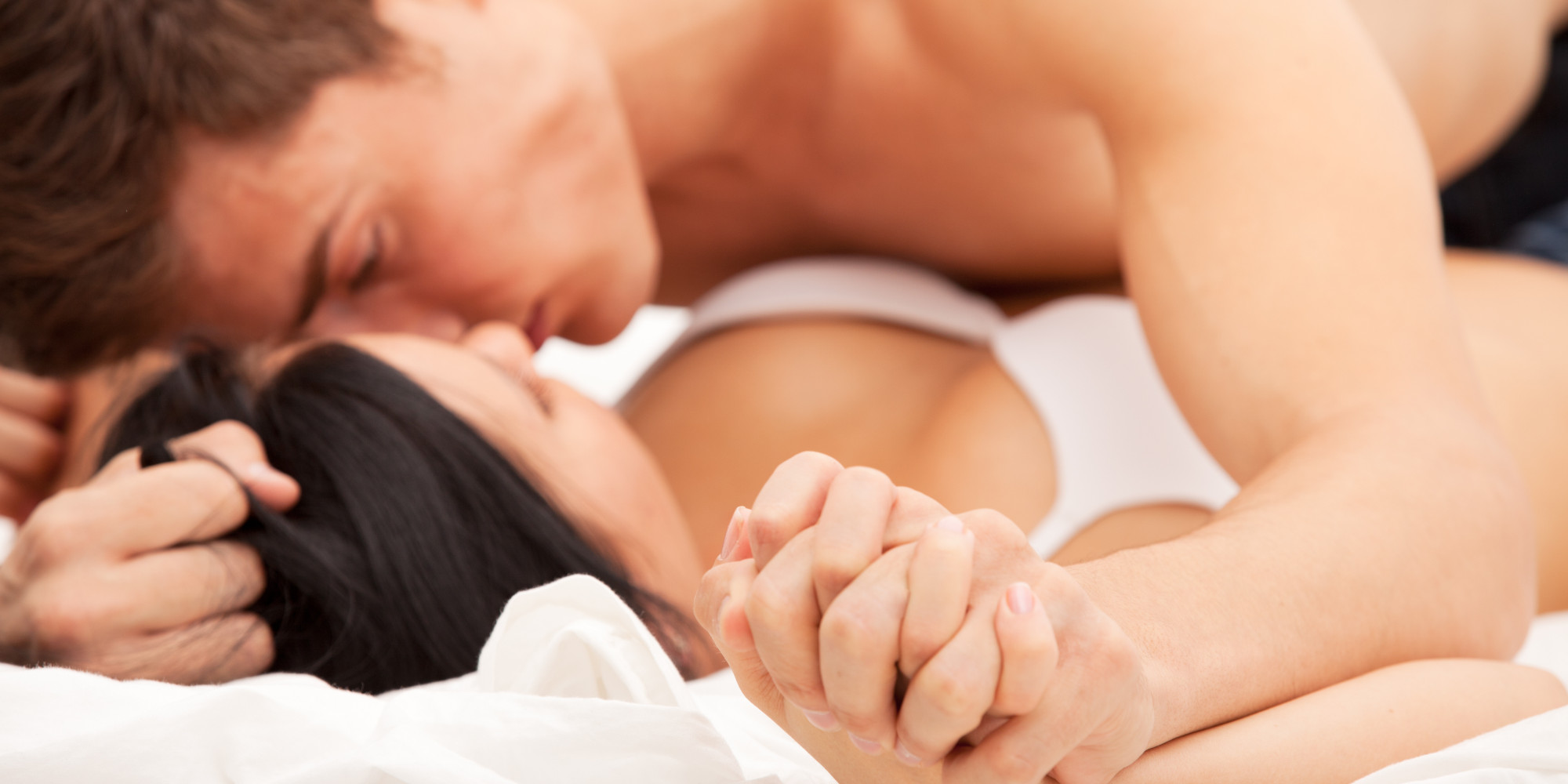 hot couple having sex in spoon position
