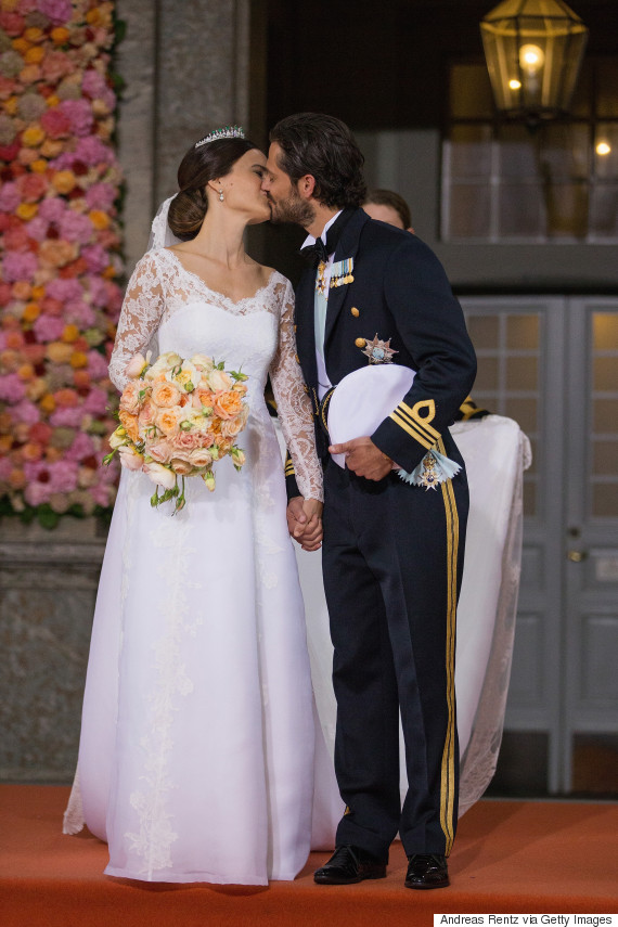 Sweden 39 s prince carl philip marries reality star sofia for Swedish wedding dress designer