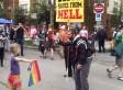 Little Girl Holds Out Rainbow Flag To Homophobic Preacher