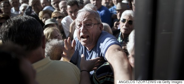 It's Total Chaos Outside Greek Banks As Savers Rush To Withdraw Money