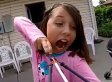Girl Pulls Tooth With Slingbow, Blows Away Tooth Fairy
