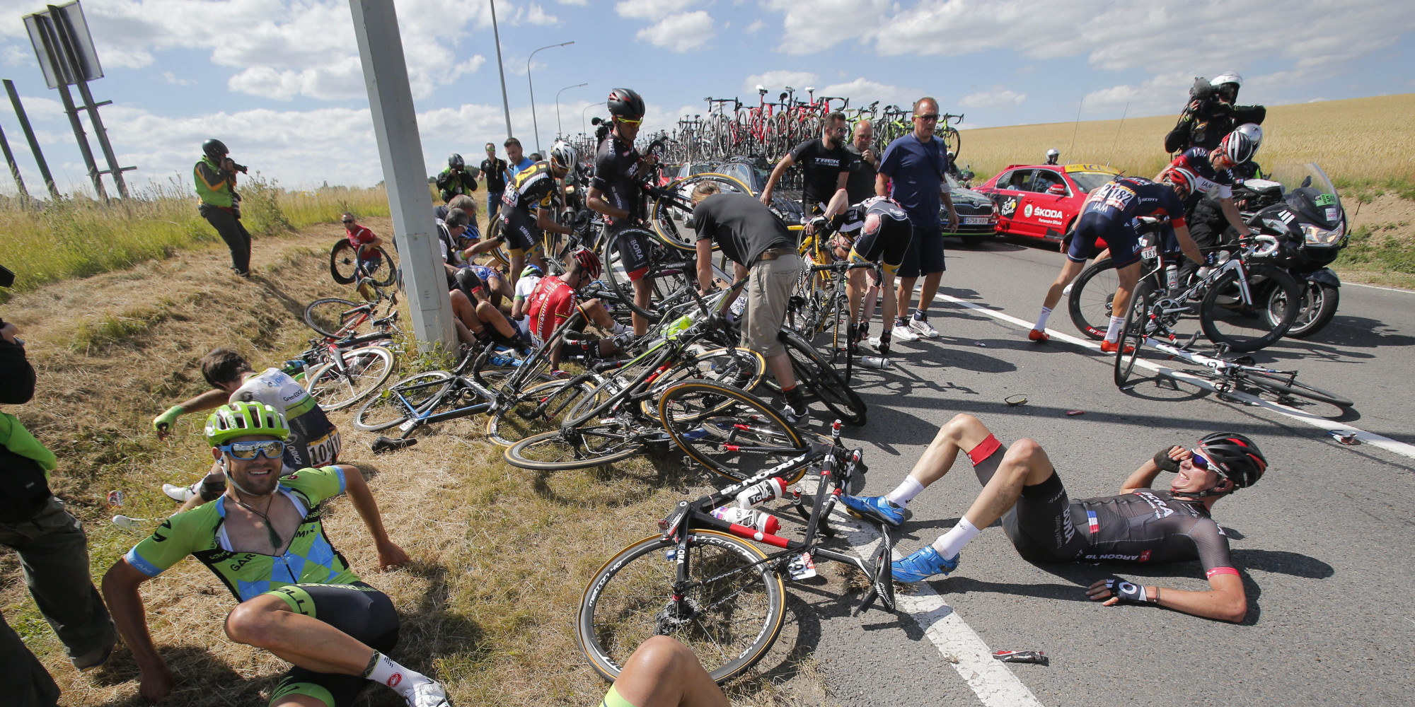 horrible tour de france crash brings down 20 riders briefly stops race huffpost. Black Bedroom Furniture Sets. Home Design Ideas