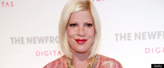 TORI SPELLING REGRETS IMPLANTS