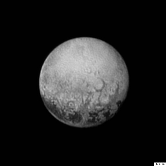 Pluto & Charon from New Horizons O-NASA-PLUTO-570